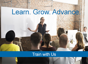 Image of training instructor in front of classroom. Learn. Grow. Advance text overlay